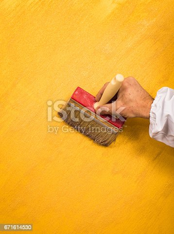 istock Hand holding wall tool,spring home decoration 671614530