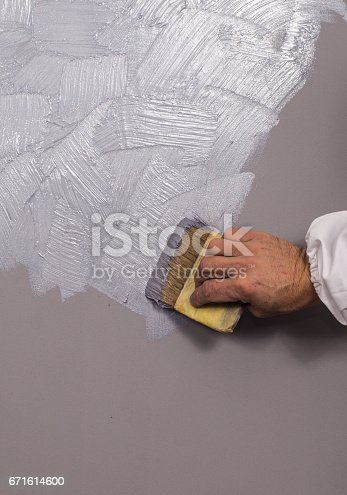 istock Hand holding wall tool,spring home decoration 671614600