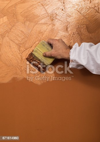 istock Hand holding wall tool,spring home decoration 671614960