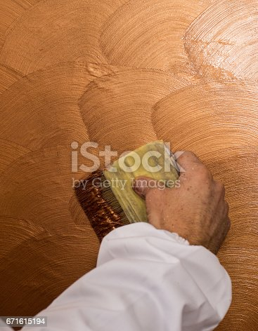 istock Hand holding wall tool,spring home decoration 671615194