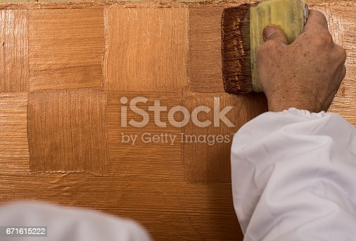 istock Hand holding wall tool,spring home decoration 671615222