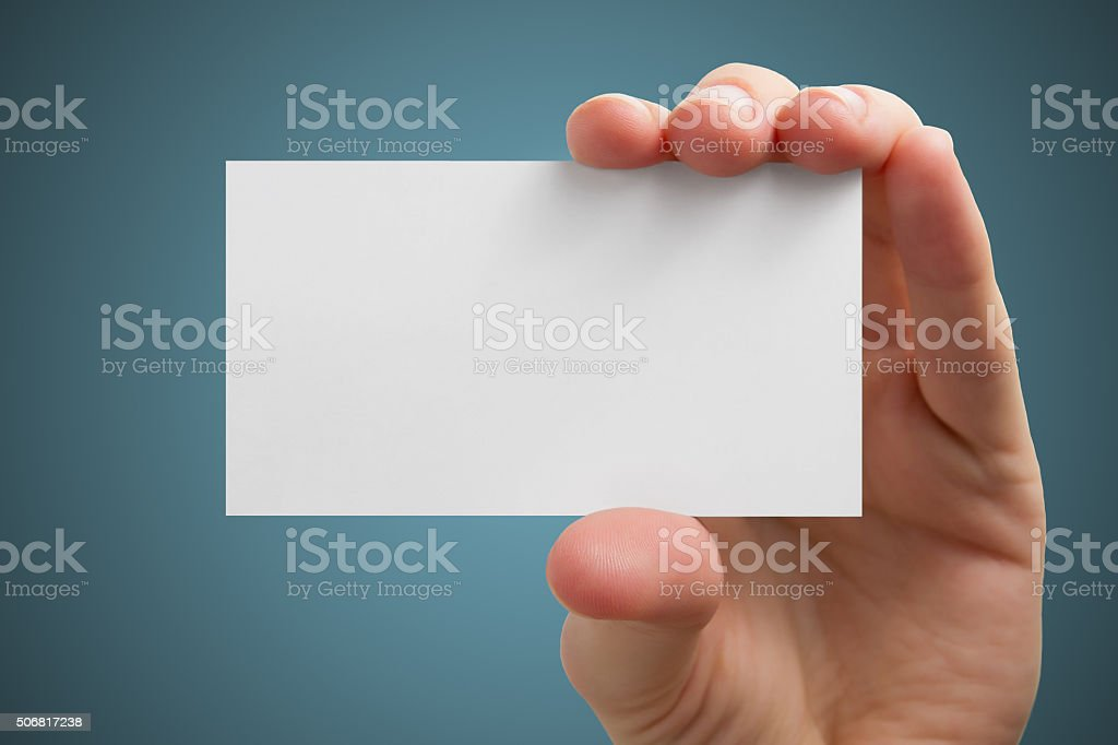 Hand holding white blank business visit card, gift, ticket, pass stock photo
