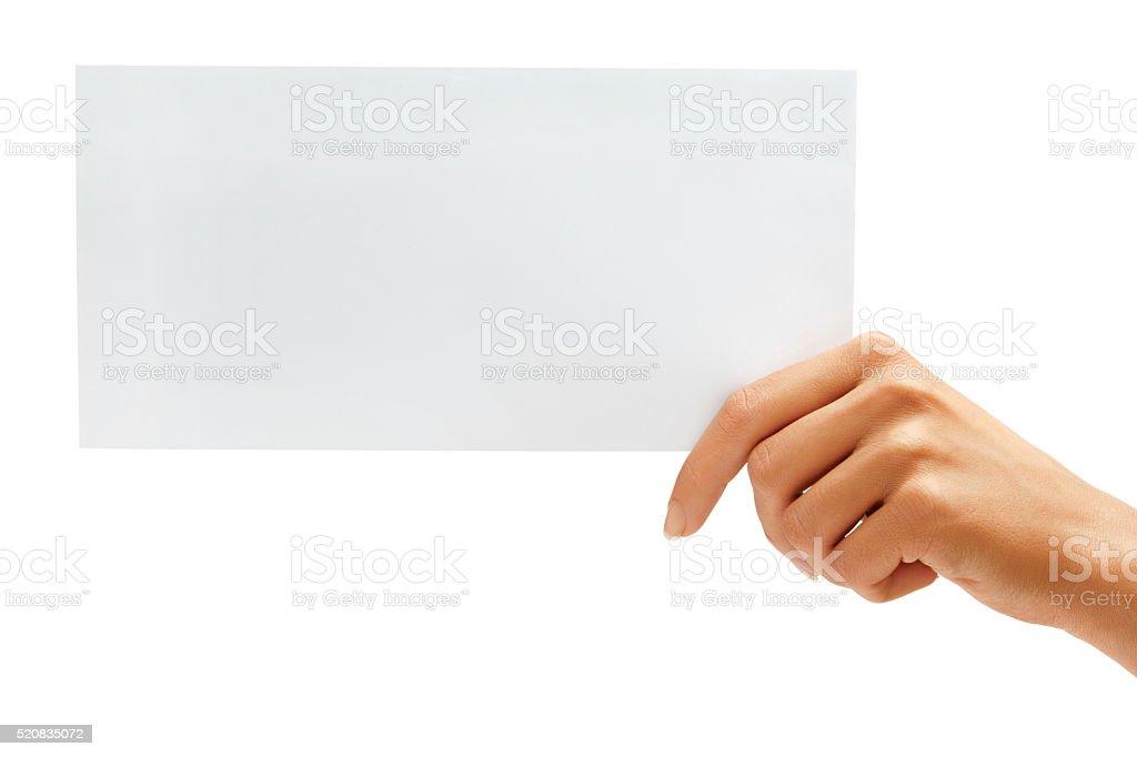 Hand holding White blank envelope stock photo