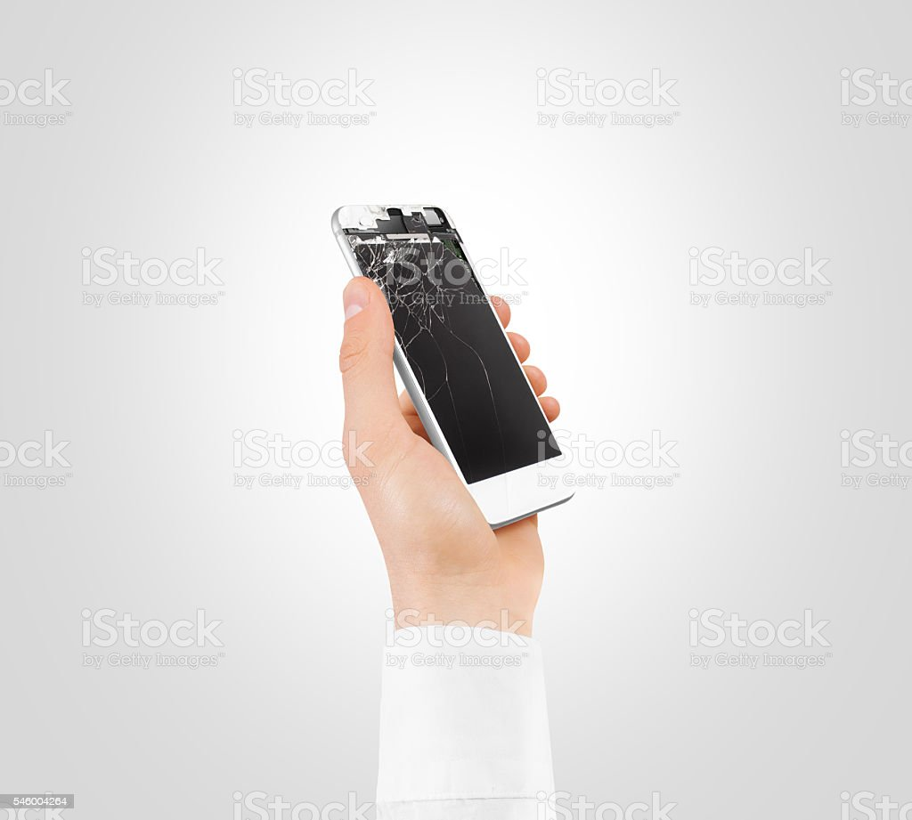 Hand holding white broken phone smashed touch screen, cipping path stock photo