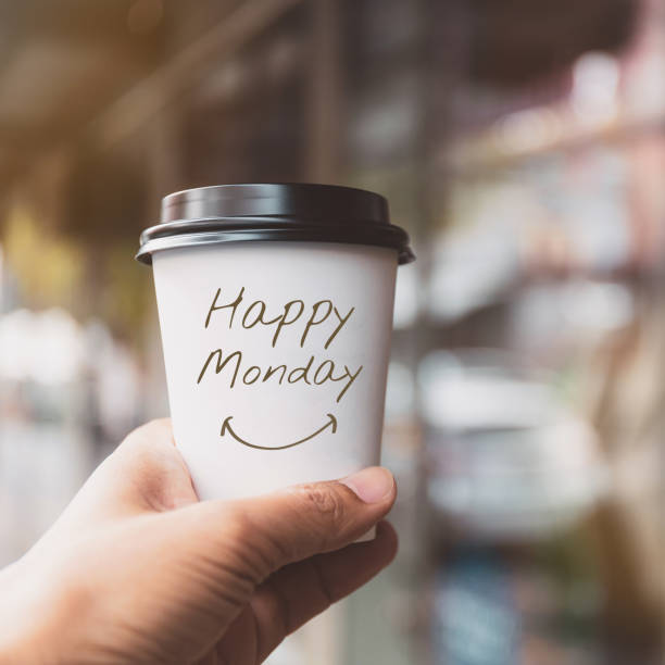 "hand holding white coffee paper cup with text ""happy monday"" on blurred window background.vintage tone, encouragement and motivation concept. - monday motivation stock photos and pictures"
