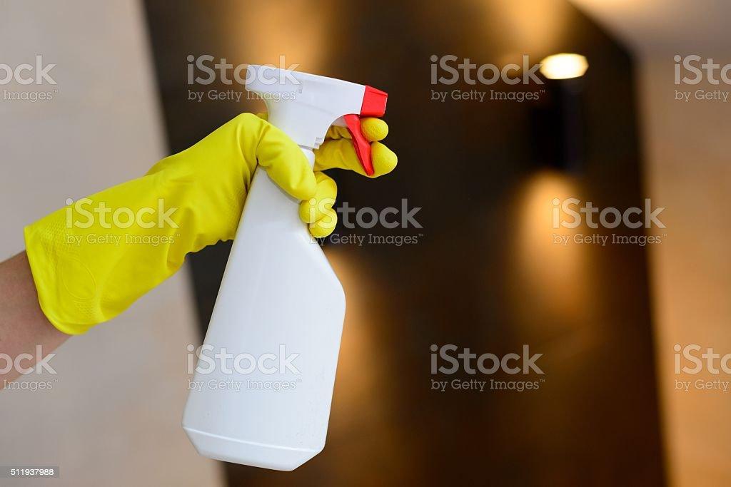 Hand holding white detergent spray bottle stock photo