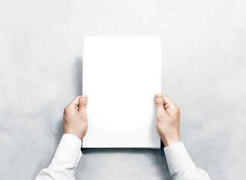 Hand Holding White Journal With Blank Cover Mockup Stockfoto en meer beelden van Afdruk