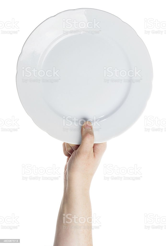 Hand holding white plate in white background stock photo
