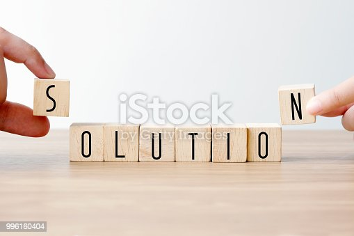 istock Hand holding wooden cubes with solution word, business concept background, mock up, template 996160404
