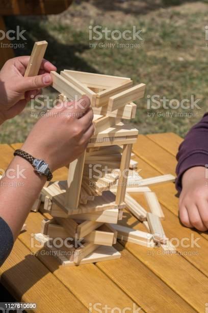 Hand holding wooden puzzle element in hand picture id1127610690?b=1&k=6&m=1127610690&s=612x612&h=yjaq lovskwph8haiqx0dpztepwbwb9n9q22wgmg9qu=