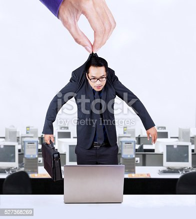 istock Hand holding worker in office 527368269
