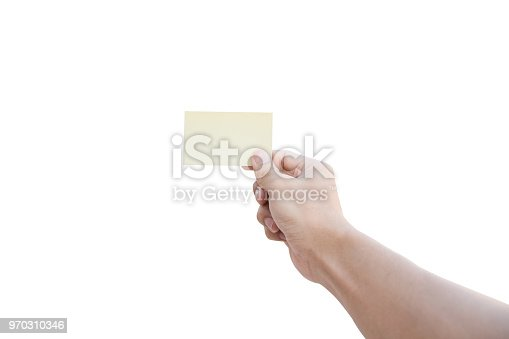 istock Hand holding yellow paper isolated on white background with clipping path 970310346