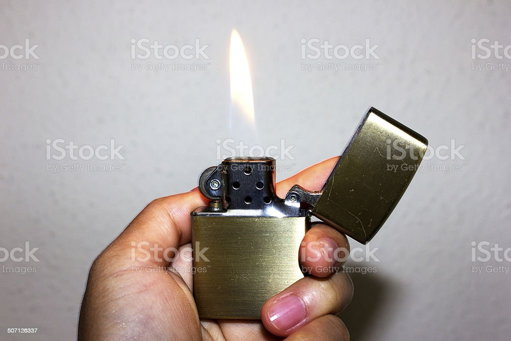 Hand Holding Zippo Lighter Stock Photo More Pictures Of Burning