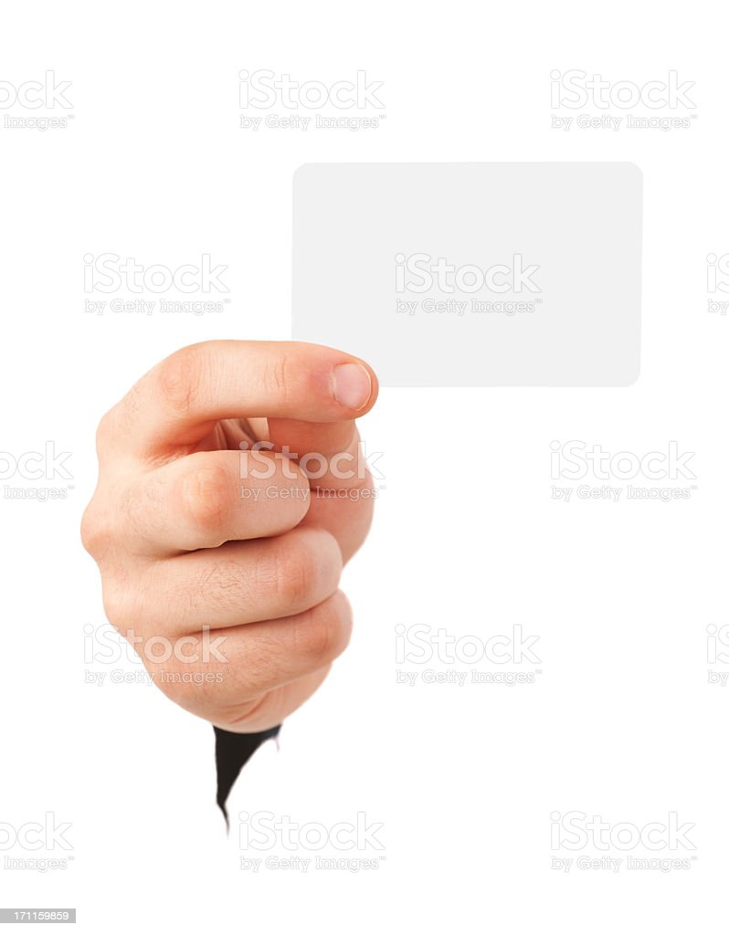 A hand holds a blank business card facing the viewer royalty-free stock photo