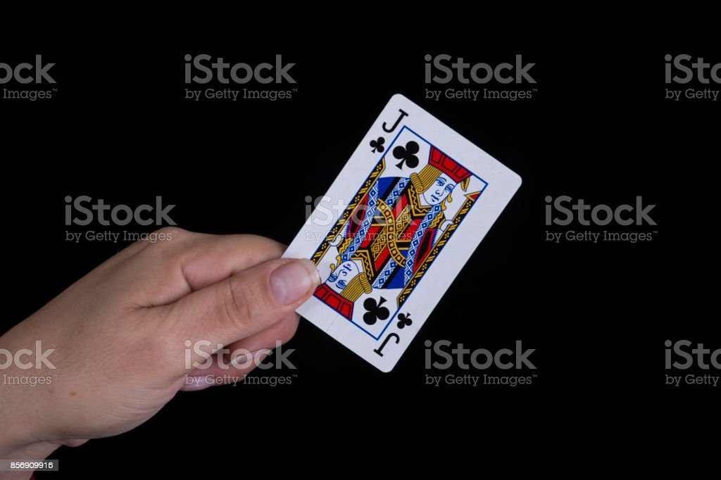 Hand holds a jack of clubs card stock photo