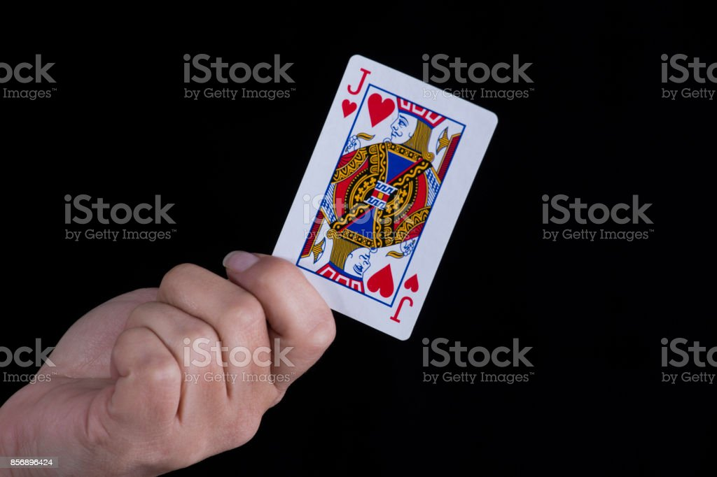 Hand holds a jack of hearts card stock photo