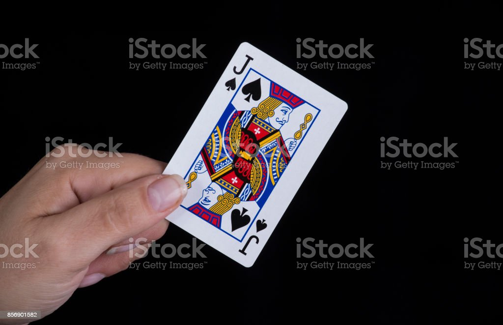 Hand holds a jack of spades card stock photo