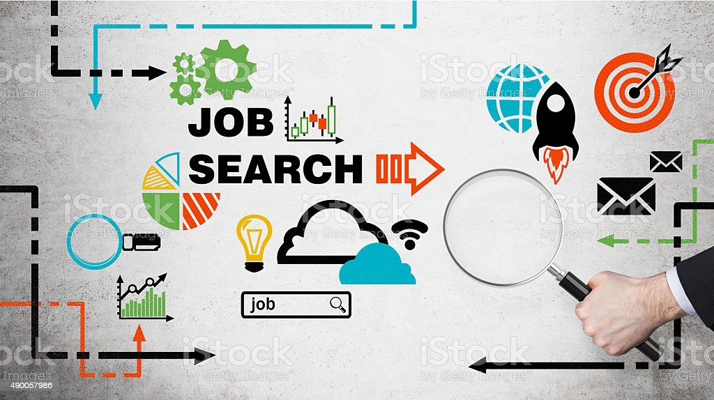 hand holds a magnifying glass. Job searching icons stock photo