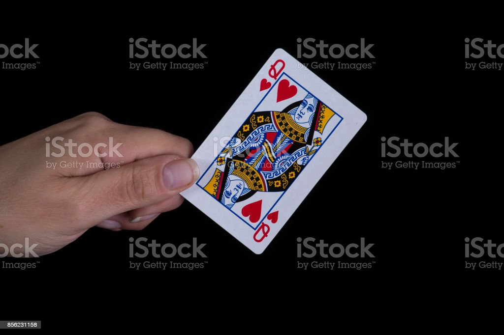 Hand holds a queen of hearts card stock photo