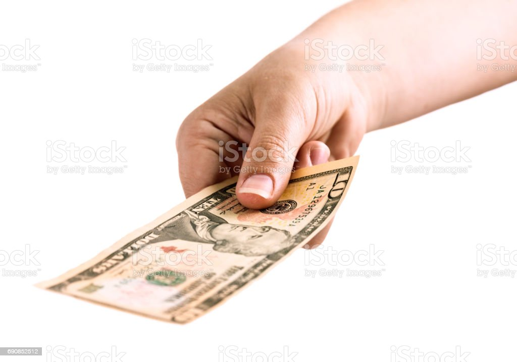 Hand holds American Ten Dollar banknote towards camera stock photo
