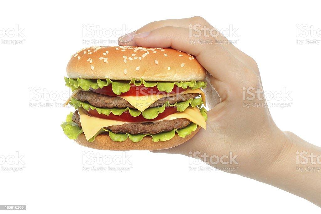 Hand holds big hamburger stock photo