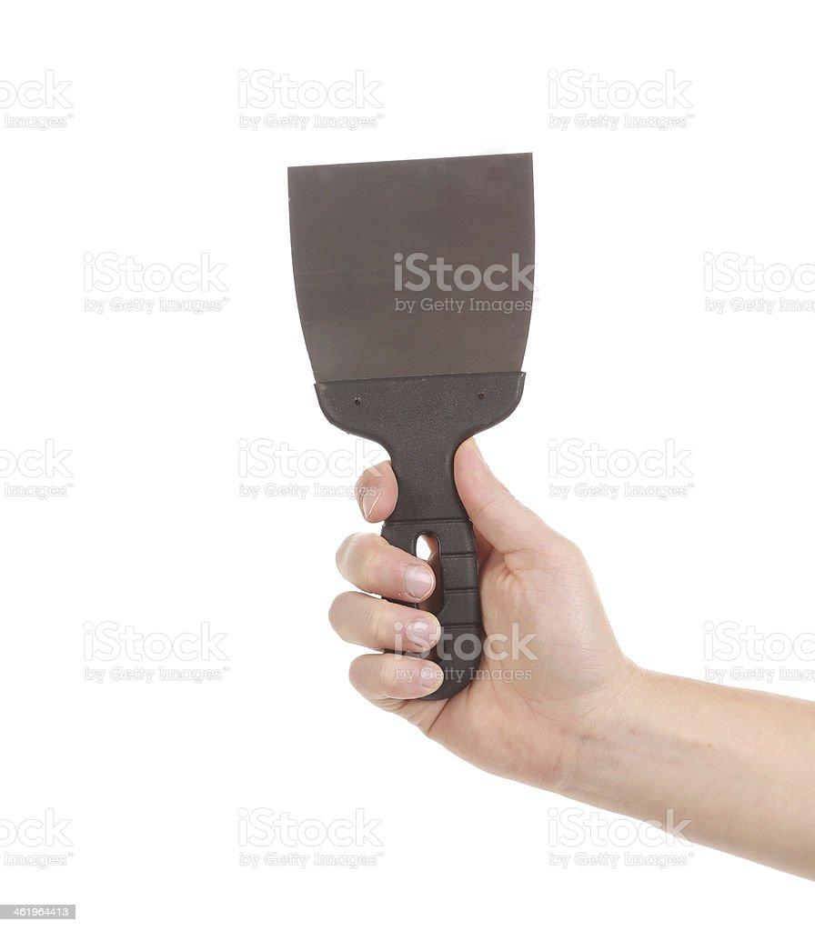 Hand holds construction spatula. stock photo