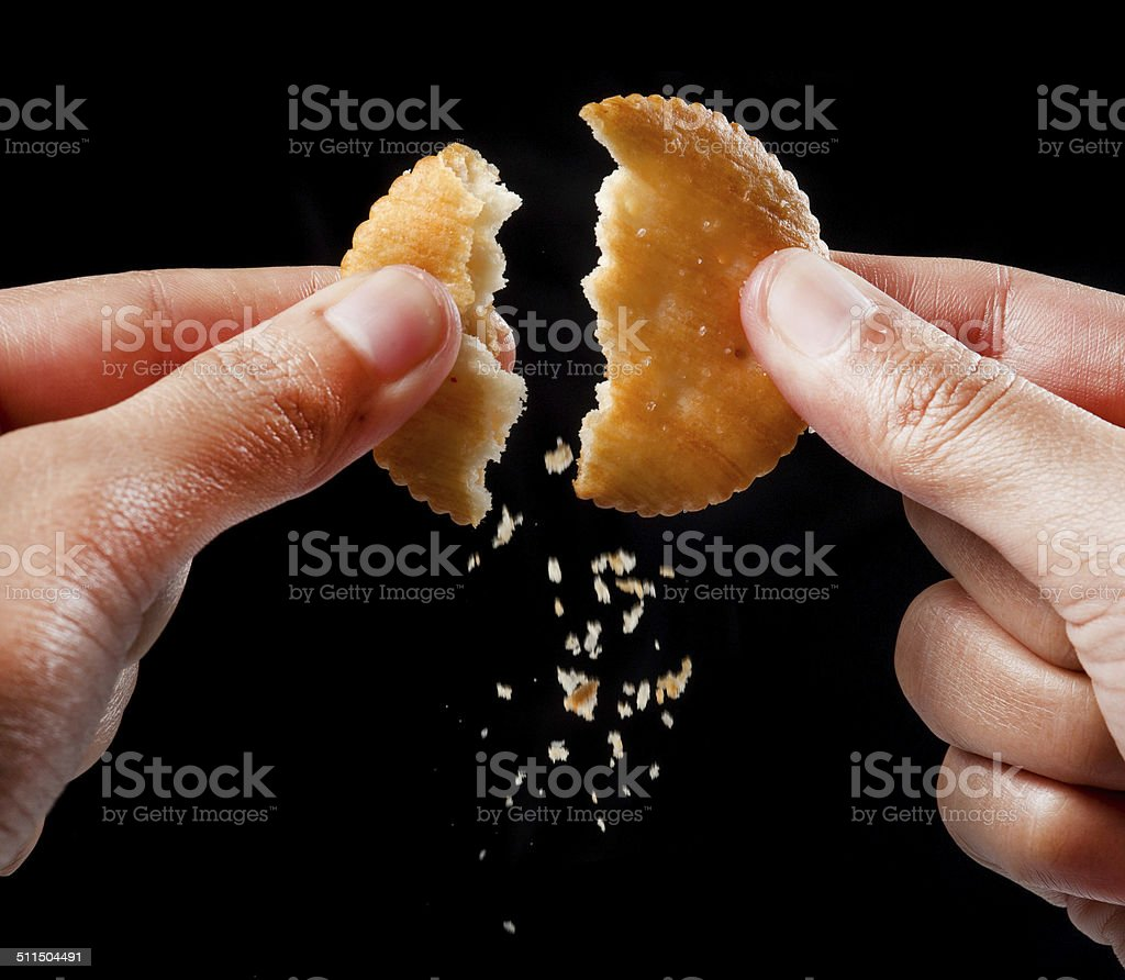 Hand holds cookie biscuits with filling stock photo