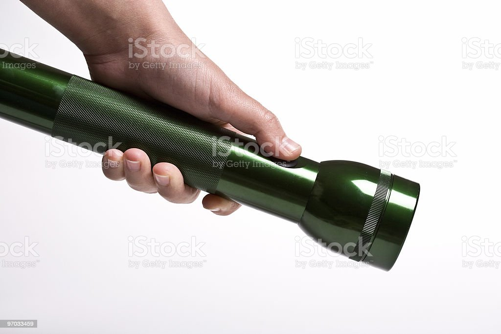 Hand holds flashlight - isolated on white royalty-free stock photo