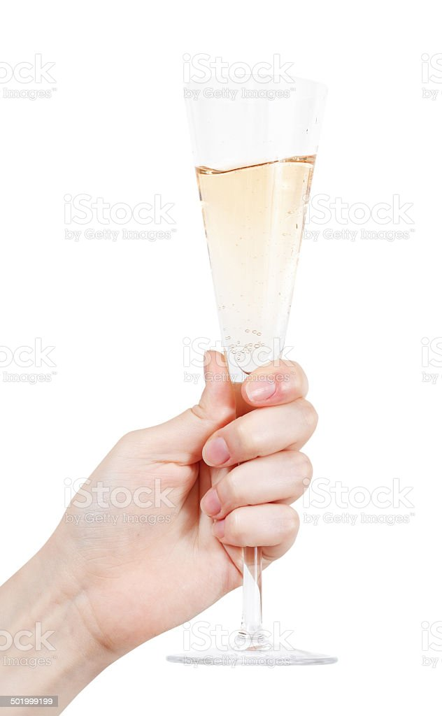 hand holds flute glass with champagne stock photo