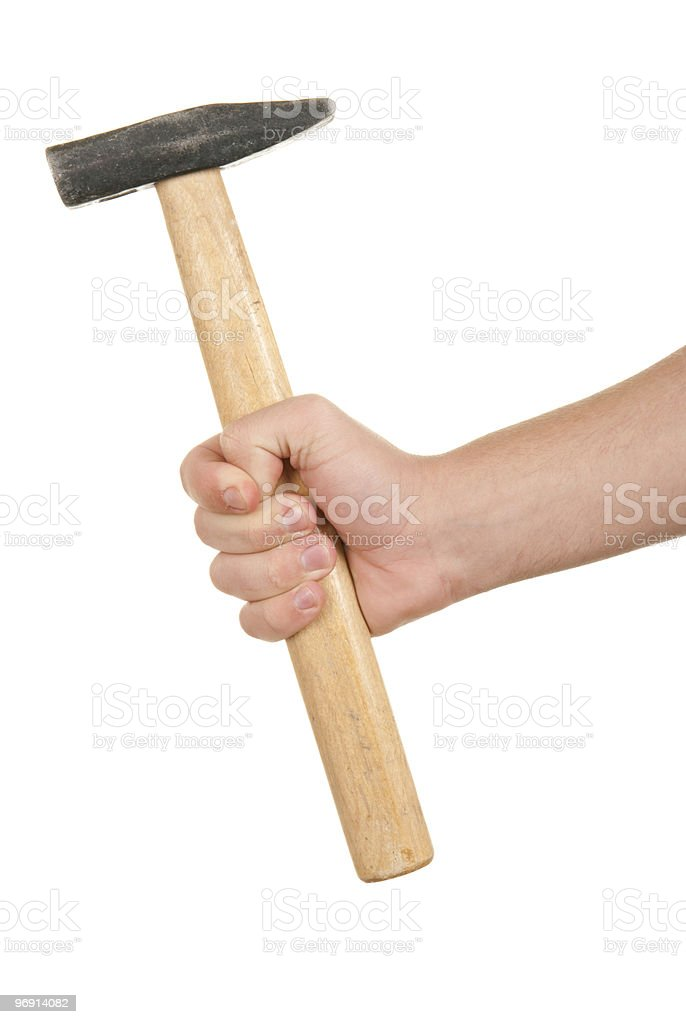 Hand holds hammer royalty-free stock photo