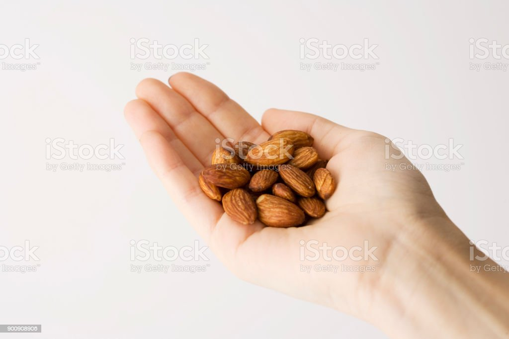 Hand holds nuts isolated on white stock photo