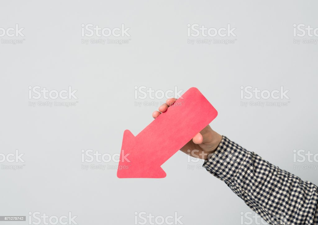 Hand holds red arrow stock photo