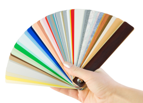 hand holds samples of blinds