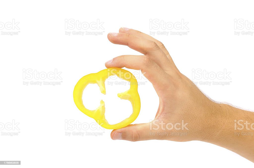 Hand holds slice of yellow pepper. royalty-free stock photo