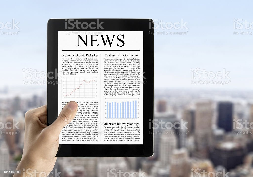 Hand Holds Tablet PC With News stock photo