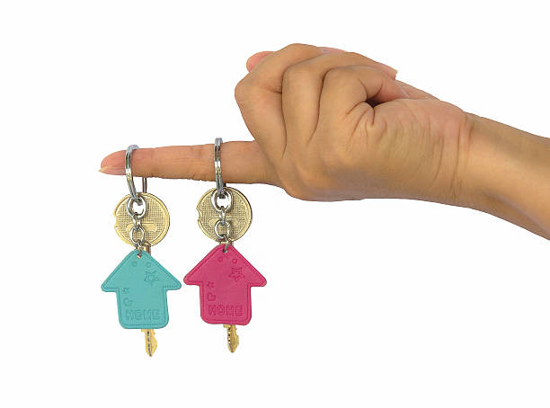 hand holds two key of the house stock photo