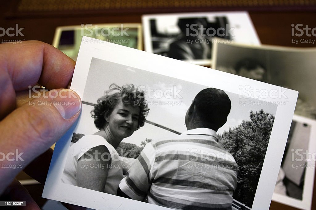 Hand holds Vintage photograph of 1950s husband and wife stock photo