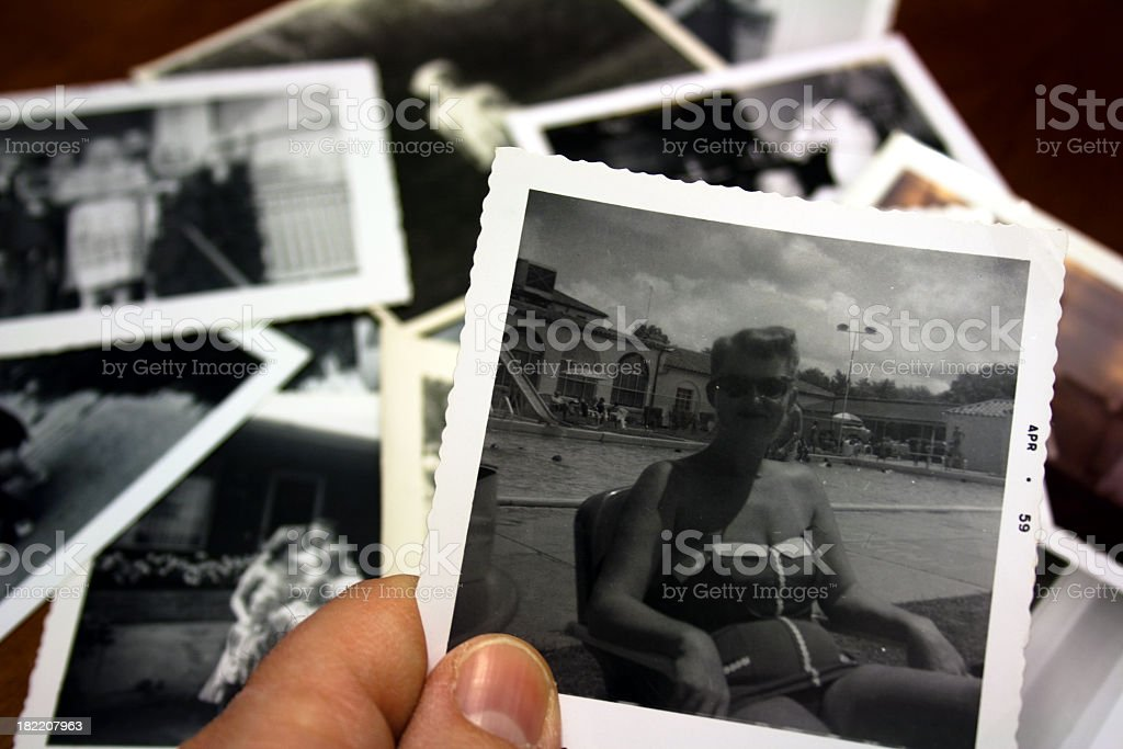 Hand holds Vintage photograph of beautiful woman in bathingsuit royalty-free stock photo