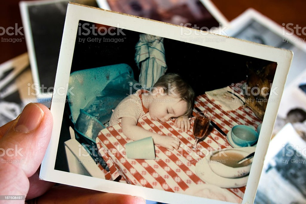Hand holds Vintage photograph of boy at thanksgiving stock photo