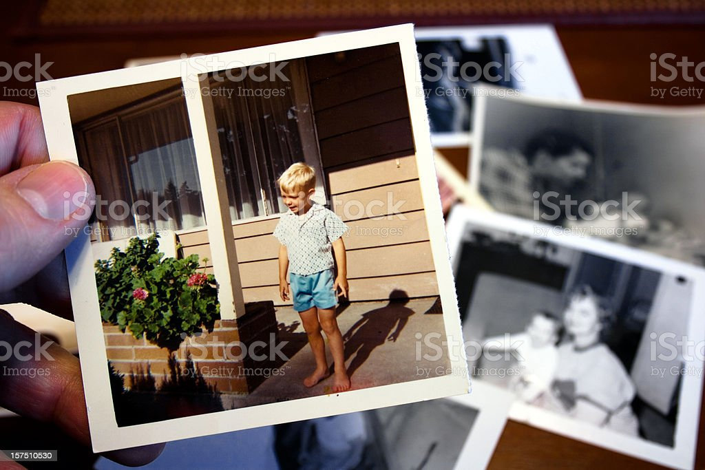 Hand holds Vintage photograph of child during summer stock photo