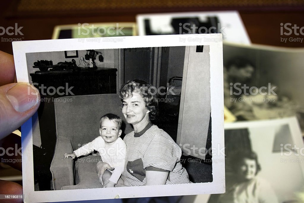 Hand holds Vintage photograph of mother and child stock photo