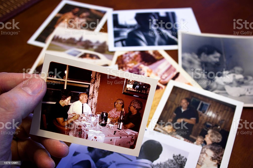 Hand holds Vintage photograph of parents and grandparent couple royalty-free stock photo