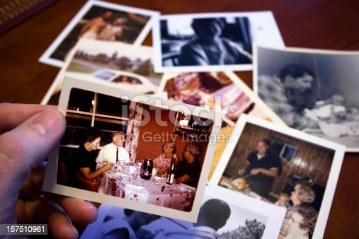 istock Hand holds Vintage photograph of parents and grandparent couple 157510961