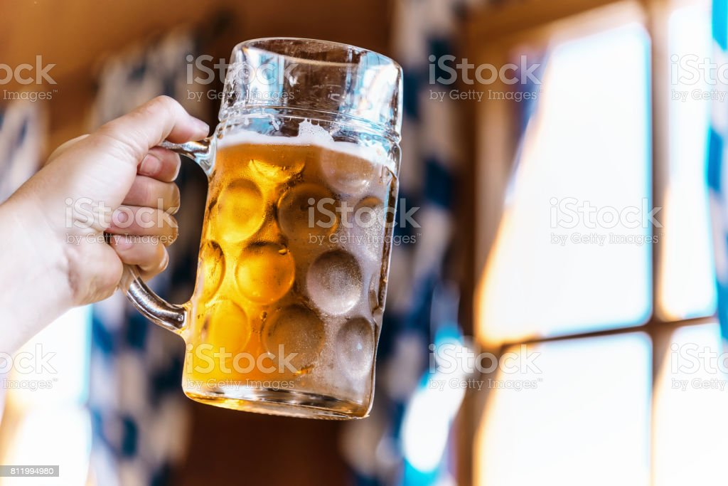 hand hunting mass-beer glasses at oktoberfest in munich stock photo