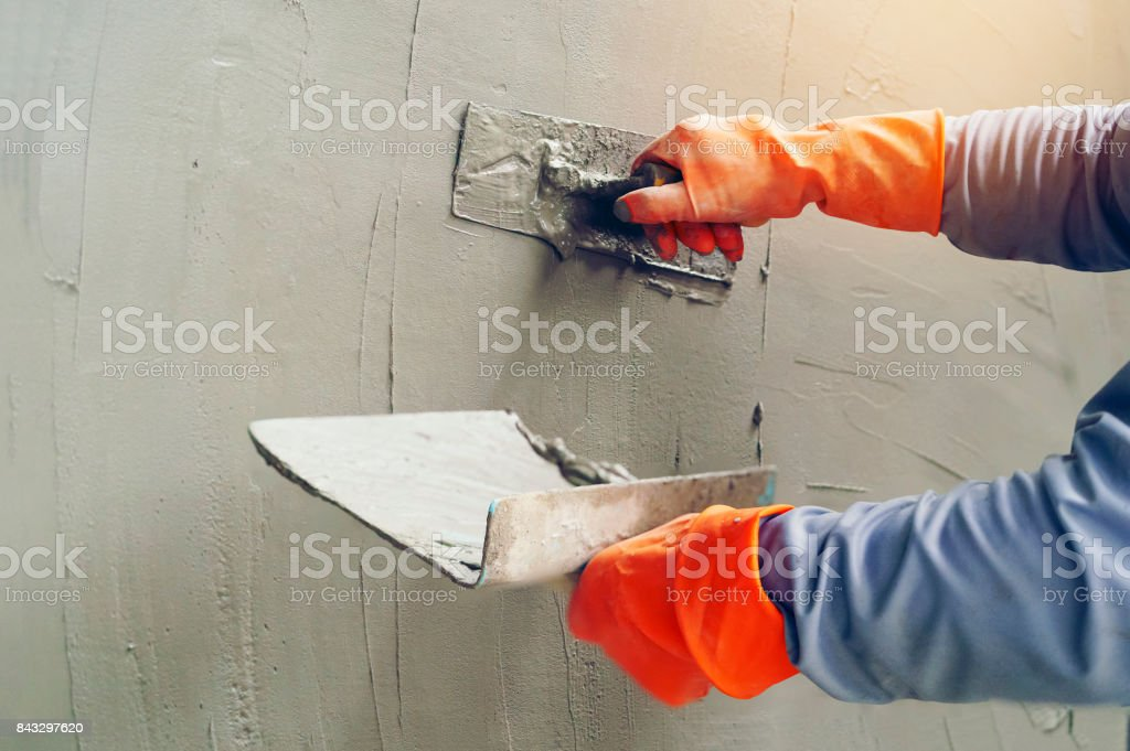 Hand image worker Concrete plaster stock photo