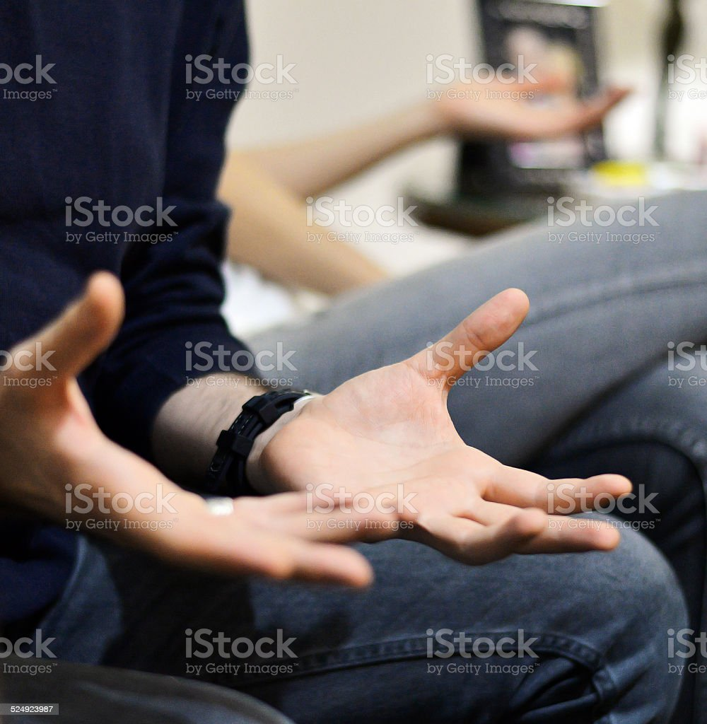 Hand in a conversation stock photo