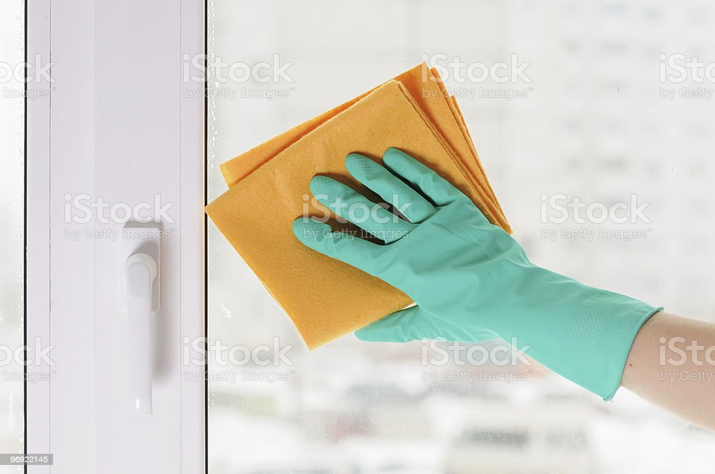 hand in a green glove royalty-free stock photo