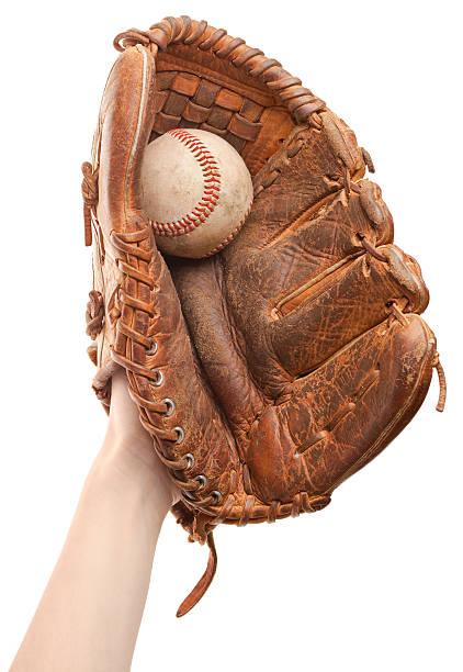 Hand in baseball glove catching ball mid-air stock photo