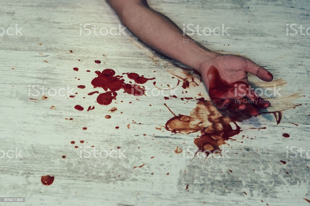 Hand in blood on a floor stock photo