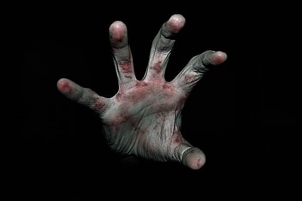 mano en la sangre - monstruo fotografías e imágenes de stock